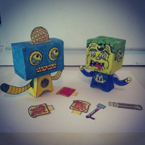 It's supposed to be #robotsvsmonsters these guys look like #friends to me! #popbloks #poptart #popart #monstersvsrobots #popblok #art #artwork #handmade #handcrafted #nocomputer #creative #paper #toys #makingthings #creating #drawing #painting #watercolor #colorful #fun #papertoys
