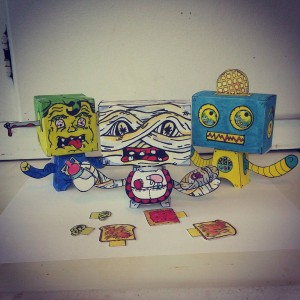 The whole #family so far! 3 more on the way! #popbloks #papertoys #handdrawn #handmade #nocomputer #painting #drawing #creating #art #artwork #colorful #fun #toys #watercolor #monsters #robots #monstersvsrobots #popblok #poptart #popart