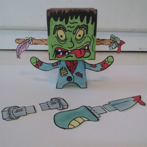 With the #arrow #throughthehead Dead Frank! #Popbloks #paper #toys #handmade #fun #colorful #nocomputer #popart #artwork #creating #makingthings #art #artist #watercolor #painting #drawing #papertoys #drawing #handcrafted #paint #monsters #frankenstein #popblok